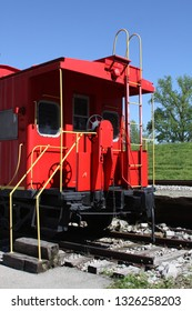 Red train caboose waits for new passangers.