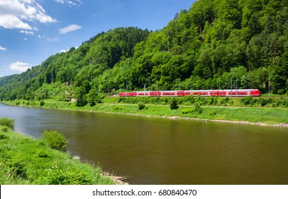 Red train on the banks of the Elbe river on the border of Germany and the Czech Republic