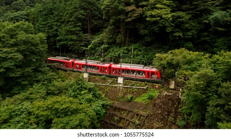 A red train standing by on the hilltop at Hakone, Tokyo, Japan