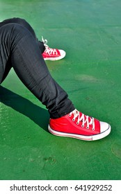 Red trainers on green background