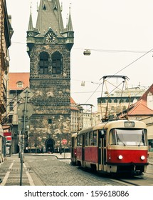 Red tram at old street in Prague. Prague historical Center