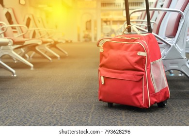 Red travel bag  in airport terminal