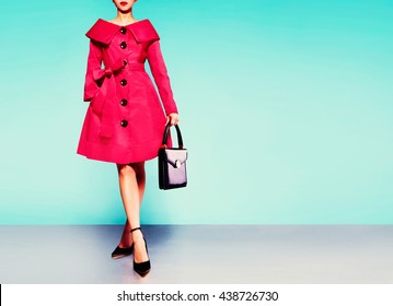 Red trench coat woman isolated on colorful  background.Vintage retro style.