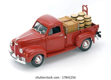 Red truck with barrels on isolated white