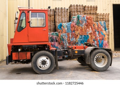 Red Truck Cab, Bales of Colorful Rope Remnants and Wooden Pallets