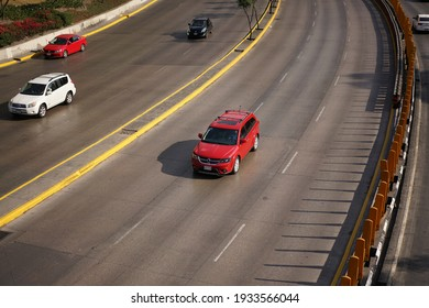 Red truck driven on main avenue in Mexico, Mexico City. 20 April, 2019