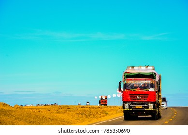 red truck driving on a highway in scenic area to deliver goods and produces for people. logistic and background concept.