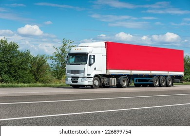 red truck on road. cargo transportation
