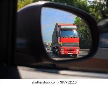 red truck reflection in a car mirror