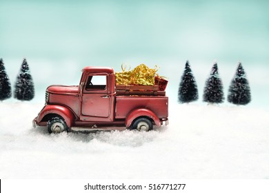 Red Truck Toy Carrying A Christmas Gift On Sweet Pastel Retro Turquoise Color Background