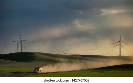 Red truck and wind turbines and hill in Palouse, WA