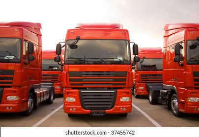 Red trucks stand in line front view