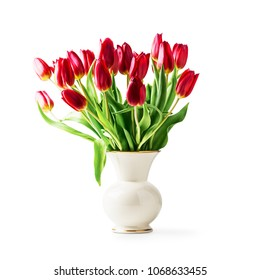 Red tulip flowers in vintage porcelain vase. Single object isolated on white background clipping path included. Spring garden flower