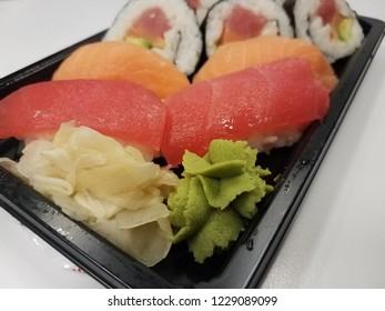 red tuna, orange salmon, and rice and seaweed sushi rolls