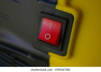Red Turn On Off power button. Toggle switch button on a yellow and black background. On and Off Symbols