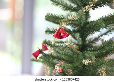 red two bell on the christmas tree in horizontal image