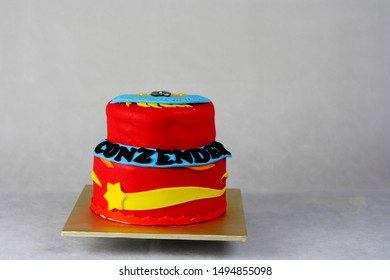 Red two tier cake bayblade inspired cake for kid birthday party