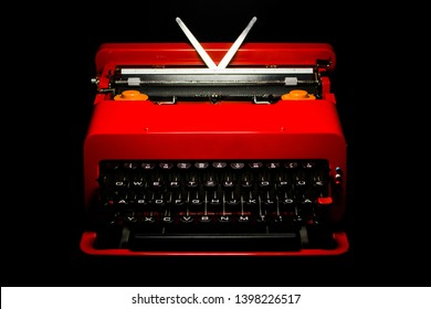 red typewriter 60s vintage valentine portable design classic icon ettore sottsass italian on black background HIGH RESOLUTION