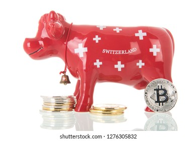 Red typical Switzerland cow piggy bank for saving money with bit coins