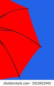 Red umbrella against blue sky