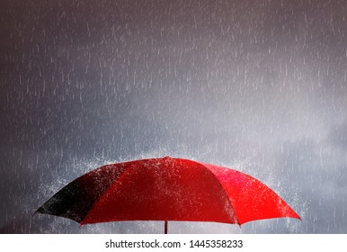 Red umbrella against the storm, sky background and black cloud group and rain, thunderstorm with savings and investment, life and accident, planning for sustainable finance