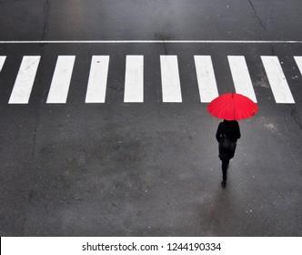 A red umbrella in the city