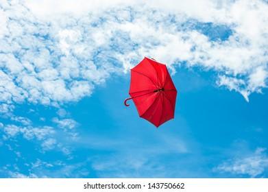 Red Umbrella flying on blue sky
