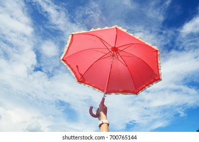 red umbrella on the blue sky