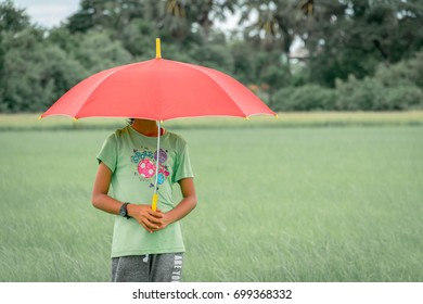 Red umbrella on her head,girl concept