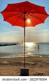 red umbrella on a sunny Thailand island beach