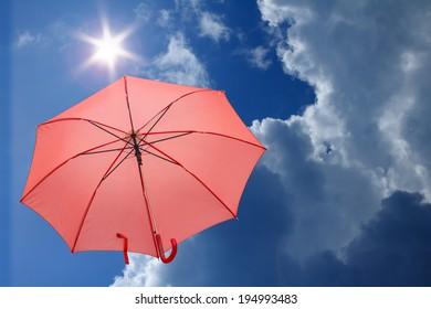 red umbrella over blue sky ,environment concept