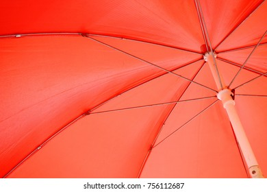 Red umbrella and pattern of its metal frames