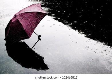 Red Umbrella in Rain