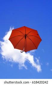 Red umbrella in the sky