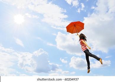 Red umbrella woman against sunlight