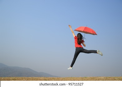 Red umbrella woman jump to Blue sky
