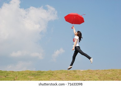 Red umbrella woman jump to sky