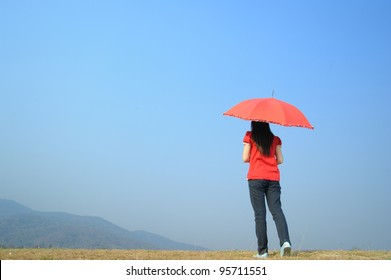 Red umbrella woman wait for someone and cloud sky