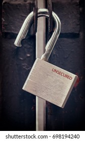 Red Unsecured Word Engraved on an Old Padlock