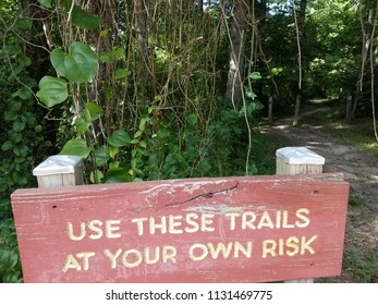 red use these trails at your own risk sign near trail