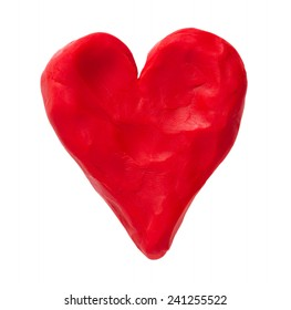 Red valentine heart made with plasticine. Isolated on white background