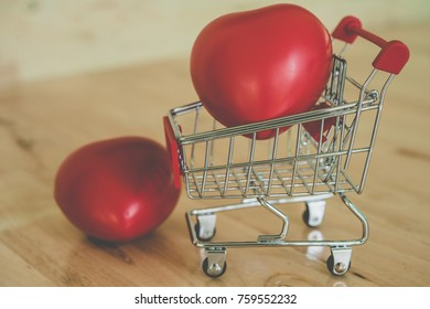 red valentine heart and shopping cart. vintage filter