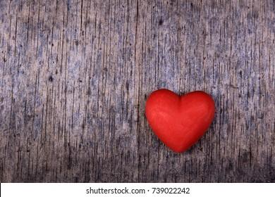 red valentine heart wood background