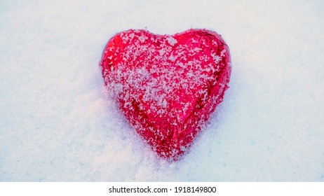 Red Valentine's heart in the snow