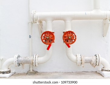 red valve fire-plump pipe on white wall