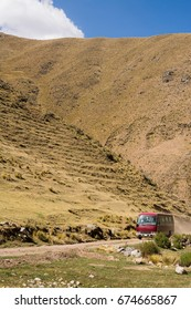 Red van on the road, passing through the mountains