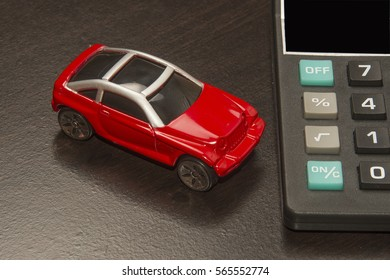 Red vehicle with calculator/Buying a New Car/Model automobile with an adding device