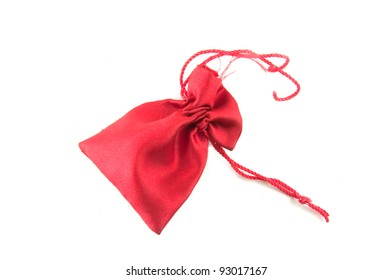 Red velvet bag for gift`s and jewelery isolated on white-Small shiny red present bag with a rope
