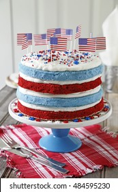 Red velvet and blue cake decorated with American flags for Independence day celebration