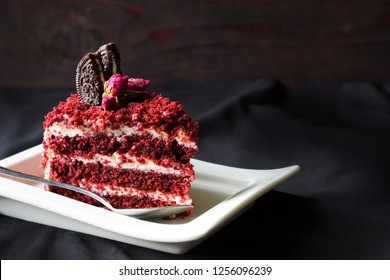 Red velvet cake decorated rose flowers on white plate